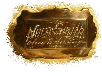 The Free Genealogy Death Record on the Coffin Plate of Nora Smith Aged 2